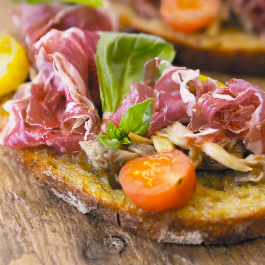 Pata negra tosta with oyster mushroom, cherry tomatoes and basil